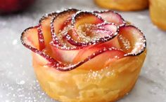 At your next dinner party, impress your guests with a dessert that is creative and delicious, a rose shaped apple dessert that will be sure to have people talking.