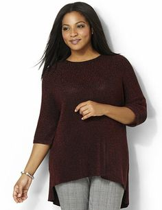 Glow brilliantly in this cozy, thick knit top. Metallic lurex yarn shines over the solid color for shimmering style. Features a ribbed scoop neckline and dolman sleeves. Complete with a hi-low hem with slits on each side. Catherines tops are designed for the plus size woman to guarantee a flattering fit. catherines.com