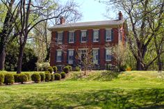 FREDERICK:  Historic Linganore Farm c.1850 - Front.  In front of the house is a terraced lawn defined with large boxwoods. In 1891, the farm was convert to a resort known as the Linganore Hills Inn.  The Linganore Farm was listed on the National Register of Historic Places in 2000.