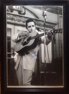 Antiquities LV - Johnny Cash Signed Poster, $2,995.00…