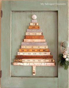"""Repurposed Folding Ruler Christmas Trees - MySalvagedTreasures.com """"Repurposed Folding Rulers, December 2011.  My stash of folding rulers was the inspiration for this Christmas tree.  I glued the ruler pieces to an old cabinet door and didn't even bother removing the hinges or knob.  I used a vintage rhinestone button as a tree topper, then added a little greenery with some tiny ornaments and a rhinestone brooch to the cabinet knob.  This one hangs in my dining room every Christmas!"""""""