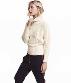 Natural white. Cable-knit turtleneck sweater in a soft cotton blend with long raglan sleeves and wide ribbing at cuffs and hem.