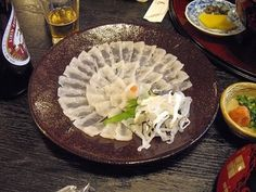[I ate] Fugu. Seeing as how i am still alive, I'd say the chef did a good job : food