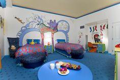Eclectic Kids Bedroom with specialty door, Birthday Express Dr. Seuss Giant Wall Decals, Crown molding, Mural, Carpet