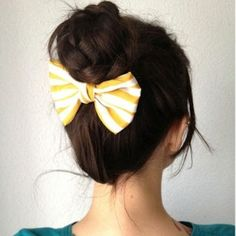 1.pull hair into a ponytail. 2.braid ponytail, secure. 3.wrap braid around base of the ponytail. 4.secure with an elastic. 5. Add a cute bow as a finishing touch!