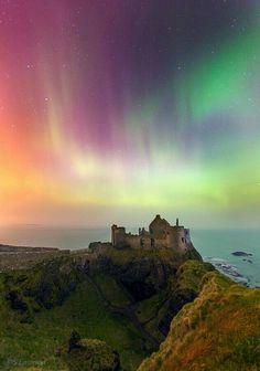 3/17/15. St Patrick's Night Aurora danced above the Dunlunce Castle in Northern Ireland