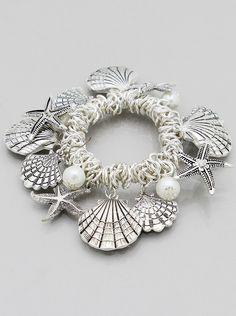 Silver tone stretch shell charm bracelet. ccfc27087c543