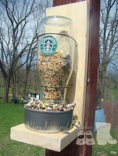 MaryJanes and Galoshes: Starbucks Bird Feeder- Tutorial Move the glass bottle down lower into the can.  Love the idea it needs to be modified...