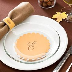 Make personalized place settings for your Thanksgiving guests with simple scrapbooking supplies. Cut circles from cardstock using decorative scissors. Then apply rub-on letters to the paper circles and place under clear glass salad plates.