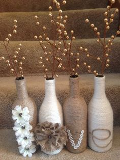 'Love' wine bottle set. Twine and yarn wrapped wine bottles for a great rustic set. Wine bottle craft.