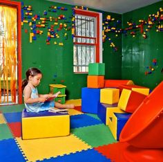 Lego wall in kids' recreation room. Should have one in our babies' room