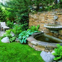 Splashy wall fountain    A two-level fountain adds a lively splash to the shady part of this Denver backyard. Water spouts from the mouth of a cast-stone ram's head into a shell-like bowl before spilling into the crescent-shaped basin below.