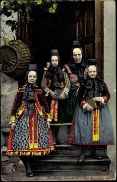 Europe | Portrait of a mother and her children wearing traditional clothes and headdress, Hessian Trachten, Hessen, Germany
