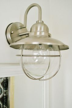 Bathroom wall mount light (seen @ young house love). pretty genius looking for a bathroom wall mount in outdoor lighting section. Nautical Bathrooms, Small Bathroom, Bathroom Wall, Bathroom Ideas, Bathroom Sconces, White Bathroom, Bathroom Pendant Lighting, Bathroom Light Fixtures, Pendant Lights