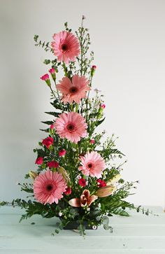 symmetrical front facing arrangement with Gerbera Daisies, mini carnations, and spiral eucalyptus. Altar Flowers, Church Flowers, Funeral Flowers, Wedding Flowers, Orchid Flowers, Easter Flower Arrangements, Beautiful Flower Arrangements, Beautiful Flowers, Fresh Flowers