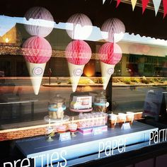 Ice cream party decor - paper cones and honeycomb balls. Cute!!