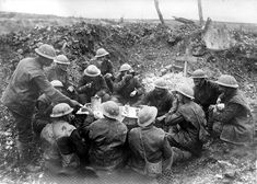 World War I in Photos: The Western Front, Part I - The Atlantic. On the British front, Christmas Dinner, 1916, in a shell hole beside a grave. (Bibliotheque nationale de France)