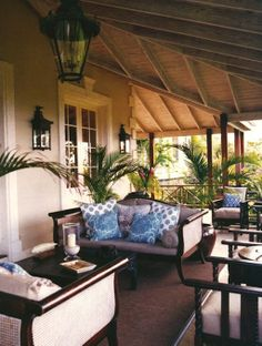 The ceiling, dark timber and greenery give this a wonderful British Colonial / Tropical feel