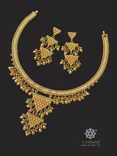 Mini Teota Necklace : A fashionable , light, casual –wear necklace that combines a kamal har with a two- storied teota centerpiece and creates volume by the liberal use of hollow ball clusters draped all along the edges. The result is generous coverage yet great economy. With matched triple –step earrings. All in pure 22K gold.