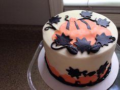 black and orange pumpkin smash cake