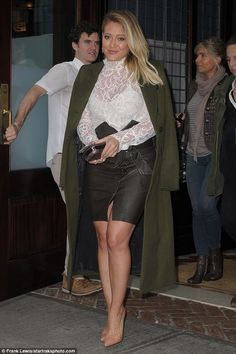 Stunning! Hilary looked gorgeous as she stepped out earlier in the day in a chic ensemble...