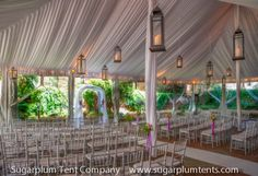 Summer #wedding with beautiful tenting and hanging lanterns by preferred vendor Sugarplum Tenting Company.