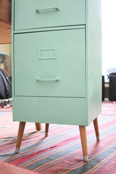 DIY Mid Century Filing Cabinet with McCobb Legs. Painted light blue/green.