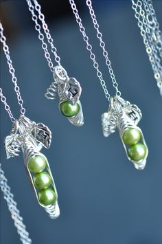 One pea, two peas, three peas.... Peas in a pod necklaces with stamped initial leaves! from muyinjewelry.com