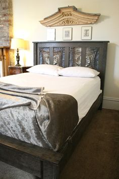 Gray Toned Bed made solely from reclaimed New Orleans doors, wood, and ceiling tin. Find out more at: http://etsy.me/1q1ru6e