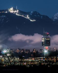 Cleared For Landing Night skiing on Grouse Mountain. The ATC tower welcomes arrivals at Vancouver International Airport (YVR) on Sea Island. Captured on Lulu Island in Richmond BC January 2 2016