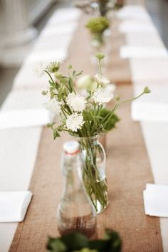 burlap runner with simple green and white flowers