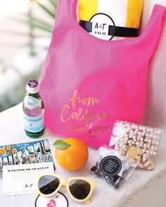 Calligraphed mini Baggu totes holding SoCal essentials: a beach towel, sunnies, and treats