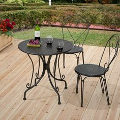 Furniture. round black wrought iron table with curving legs also black iron chairs with round seat and curving back placed on the cream wooden flooring. Enchanting Wrought Iron Dining Room Sets Make A Comfortable House Design For You