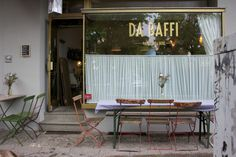 storefront:  gold lettering height relationship to outdoor cafe seating critical