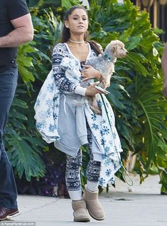 Laid-back: Ariana Grande kept comfortable in a VS Pink onesie as she was spotted carrying her dog Strauss while shopping in Los Angeles on Wednesday