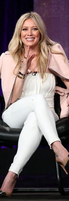 Hillary Duff, gold jewelry, white jumpsuit, pink jacket