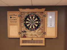 Here is a present I made for my brother who recently put a pool table in his basement. I figured he needed some darts too. Fairly basic cabinet and my first chance to use my new Festool Domino to assemble the case and the frame and panel doors. Dartboard Cabinet Plans, Cork Dartboard, Dartboard Surround, Dartboard Ideas, Dart Board Backboard, Dart Board Cabinet, Salvaged Wood Projects, Diy Furniture Making, Home Bar Cabinet