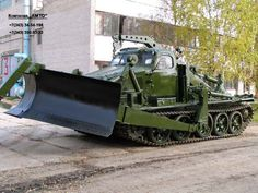 Some companies in Russia earn their living by buying cheap old Russian army vehicles and converting them to civil engineering and construction hardware that then is being used at the . Army Vehicles, Armored Vehicles, Military Engineering, Weird Cars, Crazy Cars, Heavy Duty Trucks, Soviet Army, Military Camouflage, Military Weapons