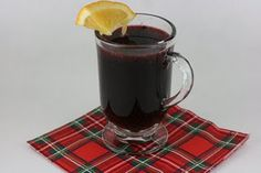 mulled wine in the slow cooker!  sounds A LOT like (swedish) glogg which is amazing... i love this stuff.