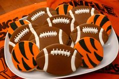 Decorated cookies for Cincinnati Bengals football game...footballs, tiger stripes, WhoDey!  www.facebook.com/cookiesbycharity