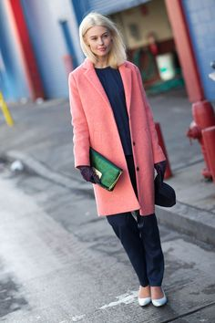 One of my favorite street style looks from #NYFW - coral coat, emerald clutch.