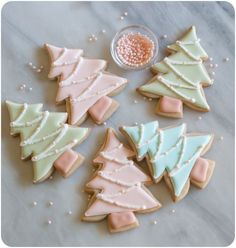 A recipe for cinnamon-sugar cut-out cookies plus tutorial for pastel Christmas tree decorated cookies.