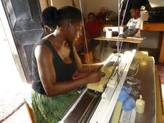 Mary learning how to use the new knitting machine! Zambia.