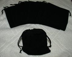 (10) Large Velvet Black Pouches With Drawstrings by Vintage Dice. $8.99. Unlined velvet pouches perfect for storing your jewelry, dice, coins or any other small item you care to keep covered.