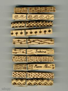 woodburn designs into mini clothespins, then color with stain....then use for polaroid display(s)