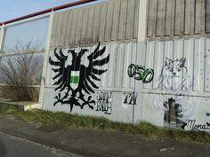 Dubbelkoppige adelaar met borstschild van het Groninger stadswapen (locatie Noordzeebrug).