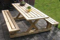 Instructables website shares how to create this picnic table  for your own family to enjoy outdoor dining.  It is made with 2x4 wood boards and hardware...