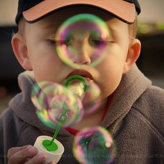 Child / Bubbles by d o l f i, via Flickr
