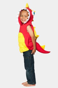Glammic kids Dragon costume with attached hood.  Features yellow wings and spikes, a ruched belly, a tooth-lined hood with 3-D eyes, and a spiked tail.  Available at Glammic.com