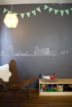 love the line drawing on the wall, and the chair and sheepskin